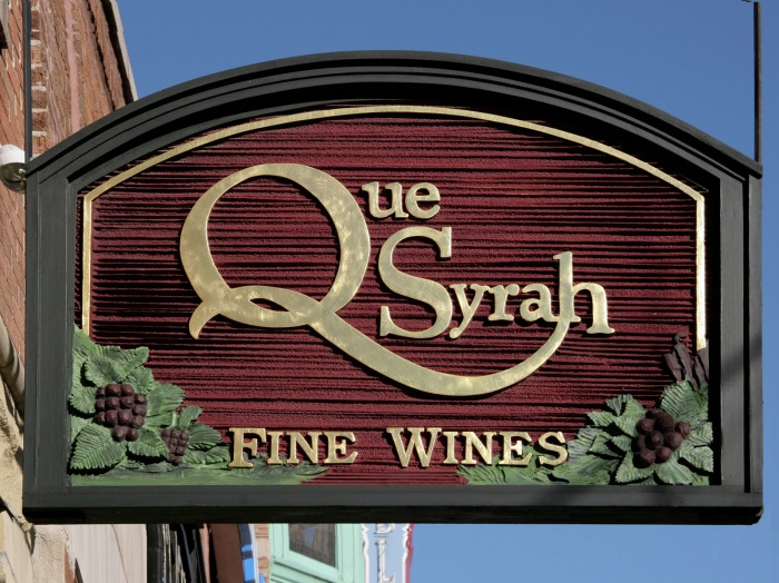 4a987c435f Image of the sandblasted HDU blade sign for the Que Syrah Wine Store in Old  Town